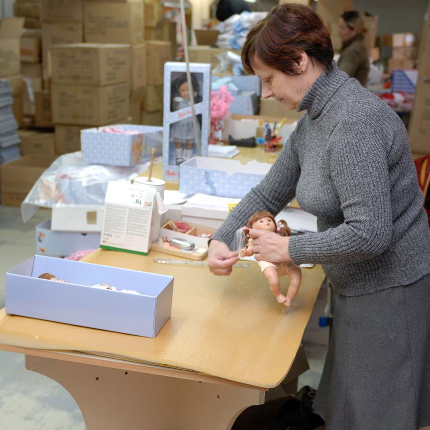 Finishing the doll making process with clothing and a box